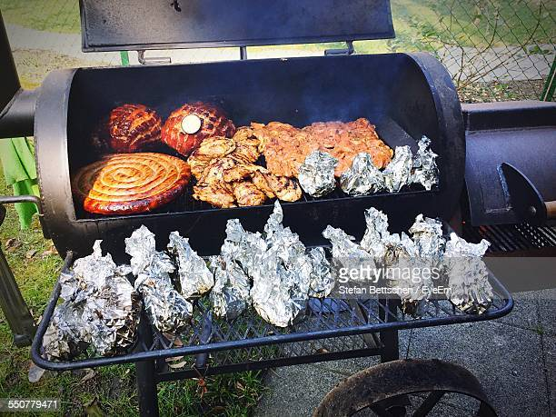 Chicken With Sausage On Barbecue Grill