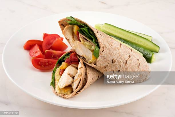 chicken wrap with whole wheat lavash - tortilla flatbread stock photos and pictures