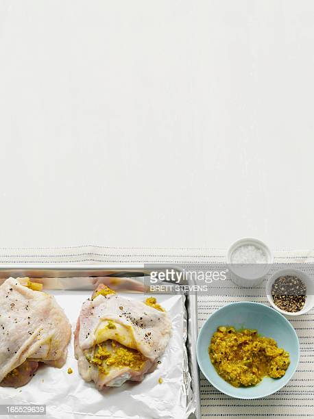 Chickens with marinade on tray