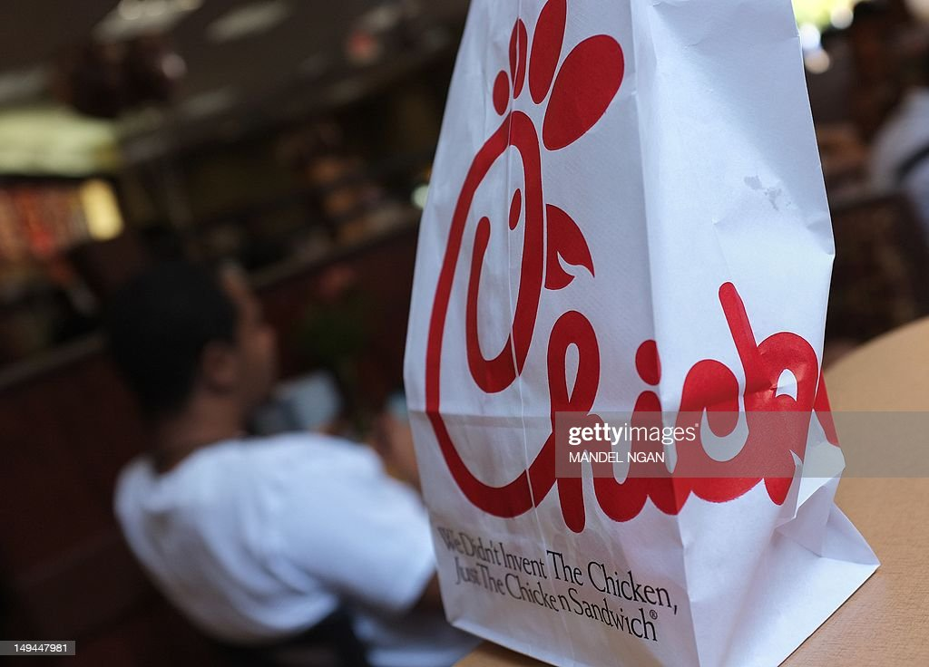 A Chick-fil-A logo is seen on a take out : News Photo