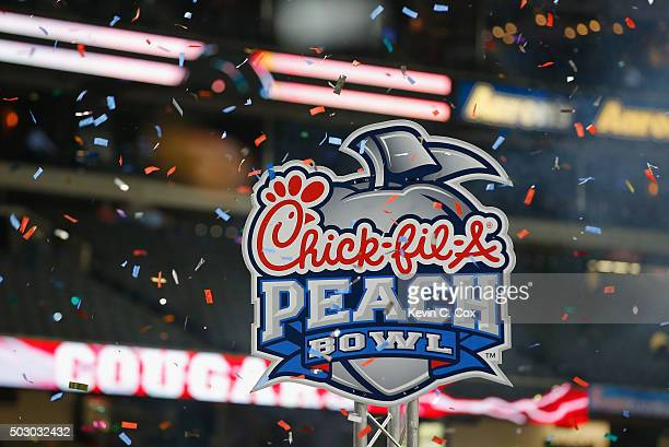 ChickfilA Peach Bowl signage is seen as confetti falls after the Houston Cougars won 3824 over the Florida State Seminoles during the ChickfilA Peach...