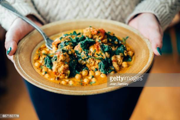chickpea and spinach curry - curry powder stock photos and pictures