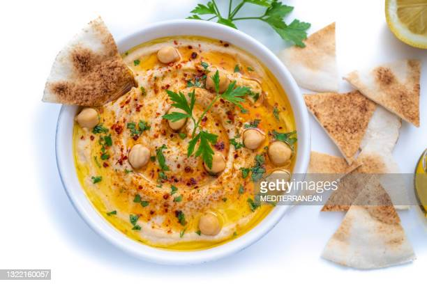 chickpea hummus bowl closeup with pita flatbread dipping isolated on white - lebanon country stock pictures, royalty-free photos & images