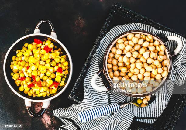 chickpeas and mixed vegetables - aniko hobel stock pictures, royalty-free photos & images