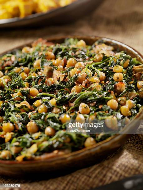 chickpeas with spinich and bacon - curry powder stock photos and pictures