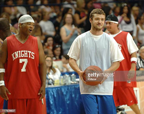 Chico Benymon and Justin Timberlake during *NSYNC's Challenge for the Children VII - Celebrity Basketball Game at Allstate Arena in Chicago,...