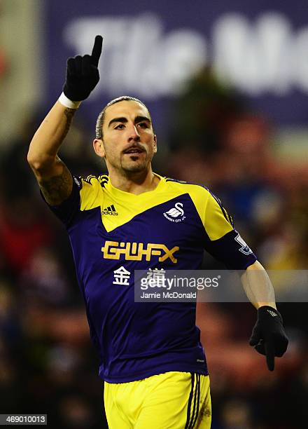 Chico Flores of Swansea City celebrates scoring during the Barclays Premier League match between Stoke City and Swansea City at the Britannia Stadium...