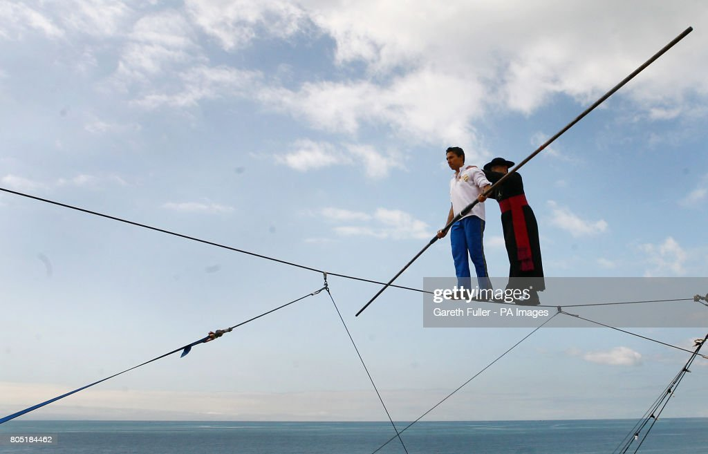 High wire walking priest Pictures | Getty Images