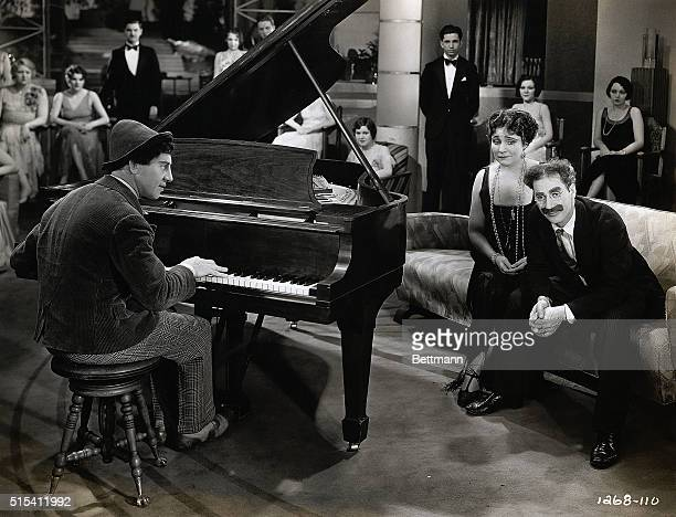 Chico Marx plays the piano for Groucho and Margaret Dumont in this movie still from 'Animal Crackers' The scene takes place early in the film at Mrs...