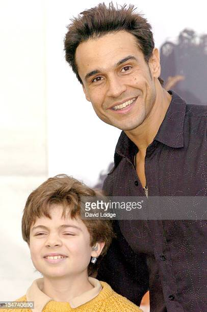 Chico Slimani of The X Factor with a patient at Great Ormond Street Hospital