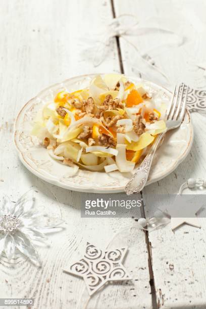 chicory salad with oranges and walnuts - rua stock pictures, royalty-free photos & images