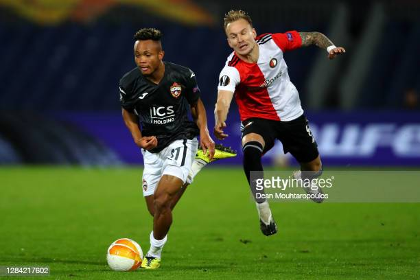 Chidera Ejuke of CSKA Moscow battles for the ball with Mark Diemers of Feyenoord Rotterdam during the UEFA Europa League Group K stage match between...