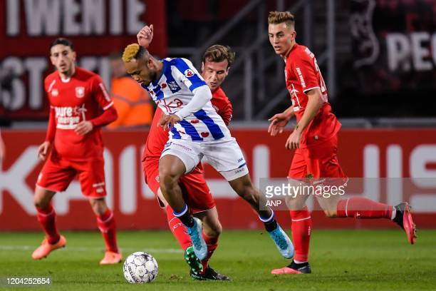 Chidera Ejuke of sc Heerenveen Peet Bijen of FC Twente Oriol Busquets of FC Twente during the Dutch Eredivisie match between FC Twente Enschede and...