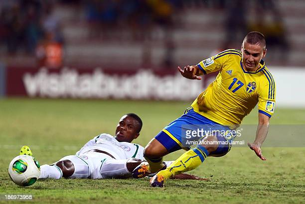 Chidiebere Nwakali and Mirza Halvadzic during the FIFA U17 World cup UAE 2013 Semi Final match between Sweden and Nigeria at Al Rashid Stadium on...