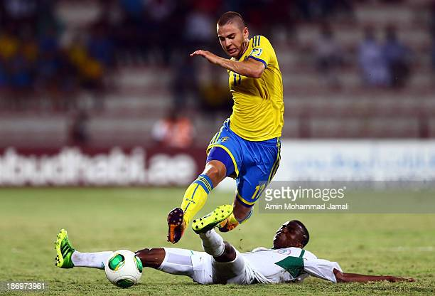 Chidiebere Nwakali of Nigeria and Mirza Halvadzic during the FIFA U17 World cup UAE 2013 Semi Final match between Sweden and Nigeria at Al Rashid...