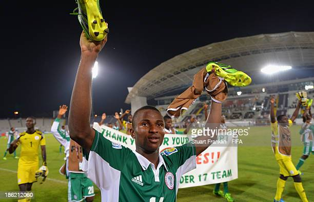 Chidiebere Nwakali of Nigeria celebrates his teams win at the end of the round of 16 match between Nigeria and Iran at Khalifa Bin Zayed Stadium on...