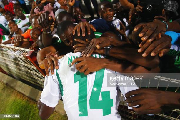 Chidiebere Nwakali of Nigeria celebrates with the fans after the FIFA U17 World Cup UAE 2013 Semi Final match between Sweden and Nigeria at Al Rashid...