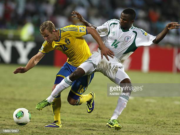 Chidiebere Nwakali of Nigeria fights for the ball against Gustav Engvall of Sweden during the two teams' semifinal in the FIFA U17 World Cup in...