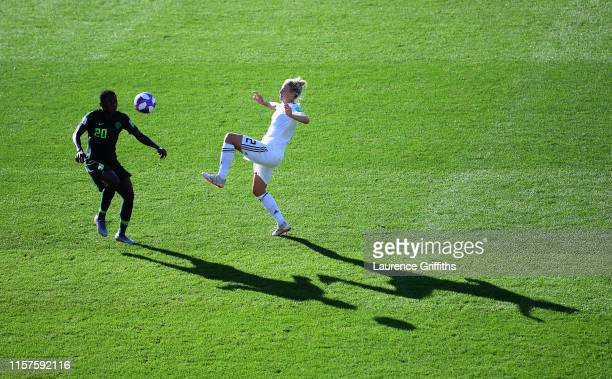 Chidinma Okeke of Nigeria is challenged by Carolin Simon of Germany during the 2019 FIFA Women's World Cup France Round Of 16 match between Germany...