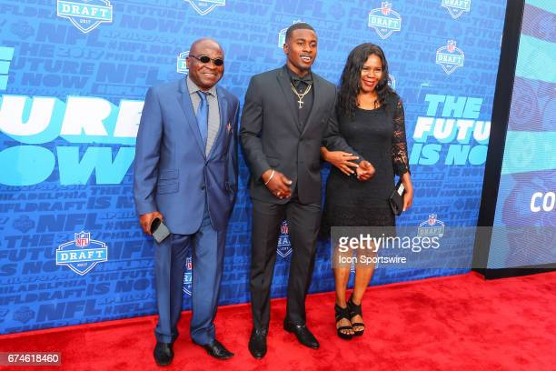 Chidobe Awuzie from Colorado with his mother Victoria on the Red Carpet outside of the NFL Draft Theater on April 27 2017 in Philadelphia PA