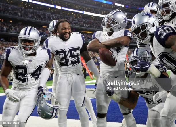 Chidobe Awuzie Kavon Frazier and other Dallas Cowboys celebrate the fourth quarter interception by Jourdan Lewis against the New Orleans Saints at...