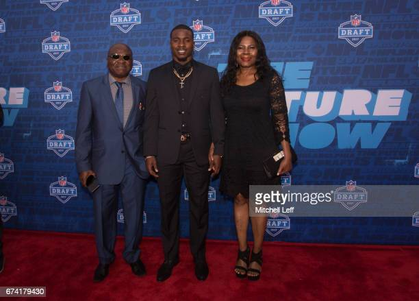 Chidobe Awuzie of Colorado poses for a picture with his family on the red carpet prior to the start of the 2017 NFL Draft on April 27 2017 in...