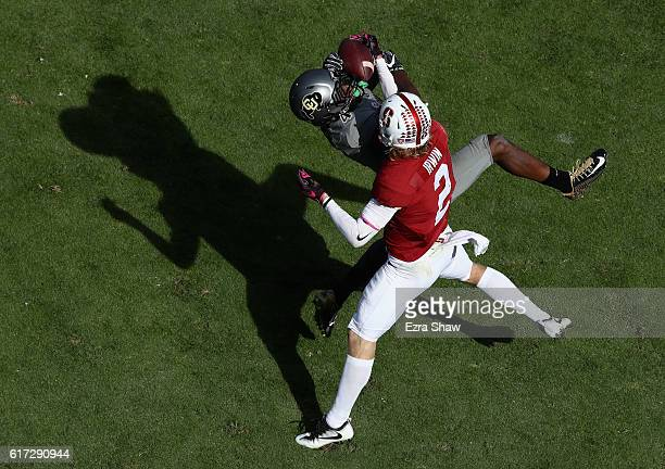 Chidobe Awuzie of the Colorado Buffaloes breaks up a pass intended for Trenton Irwin of the Stanford Cardinal at Stanford Stadium on October 22 2016...