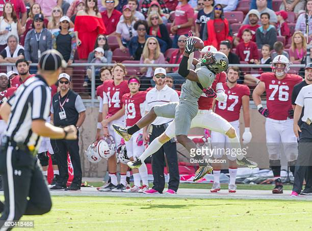 Chidobe Awuzie of the University of Colorado Buffaloes attempts to intercept a pass intended for Trenton Irwin of Stanford during an NCAA Pac12...