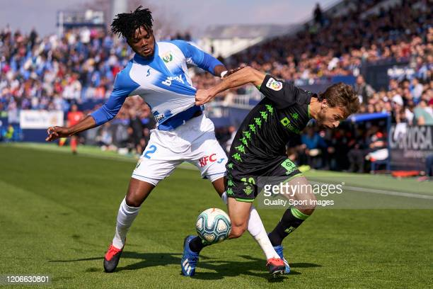 Chidozie Awaziem of CD Leganes battles for the ball with Sergio Canales of Real Betis Balompie during the Liga match between CD Leganes and Real...