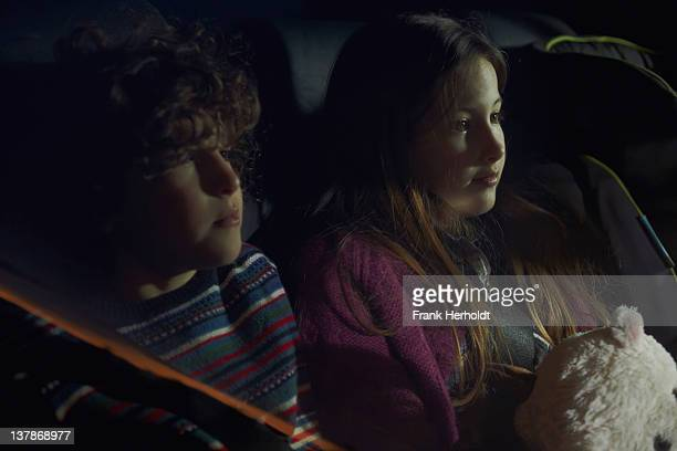 chidren in a car - newpremiumuk stock pictures, royalty-free photos & images