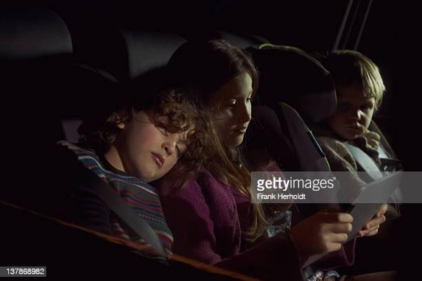 Chidren in rear seat of car