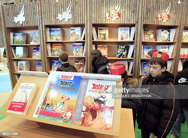 Chidren look at French Asterix famous comics from Albert Underzo and Rene Goscinny at a stand in the Paris yearly book fair on March 14 2008 The fair...