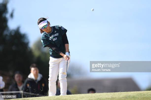 Chie Arimura of Japan chips onto the 1st green during the first round of the Yokohama Tire PRGR Ladies Cup at the Tosa Country Club on March 10 Konan...