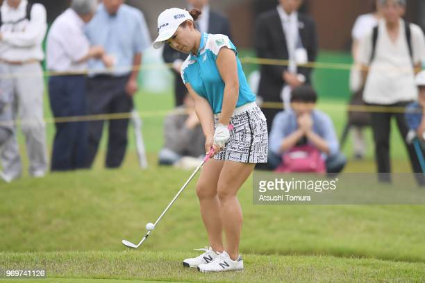 Chie Arimura of Japan chips onto the 9th hole during the second round of the Suntory Ladies Open Golf Tournament at the Rokko Kokusai Golf Club on...