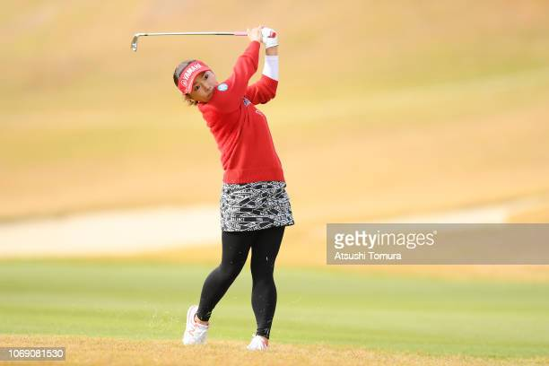 Chie Arimura of Japan hits her second shot on the 17th hole during the final round of the Daio Paper Elleair Ladies Open at Elleair Golf Club...