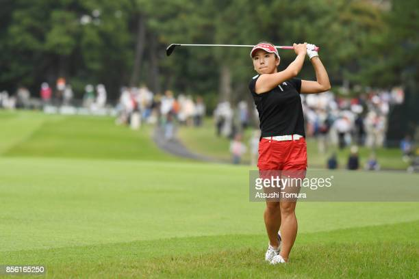 Chie Arimura of Japan hits her second shot on the 17th hole during the final round of Japan Women's Open 2017 at the Abiko Golf Club on October 1...
