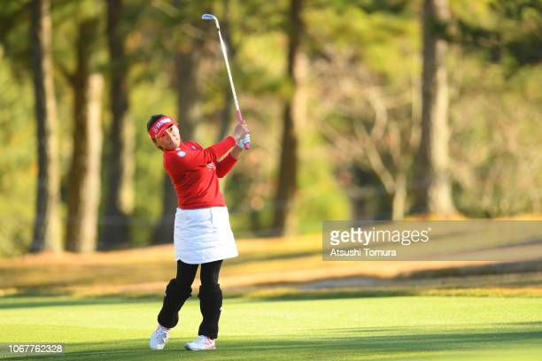 Chie Arimura of Japan hits her second shot on the 18th hole during the first round of the Daio Paper Elleair Ladies Open at Elleair Golf Club...