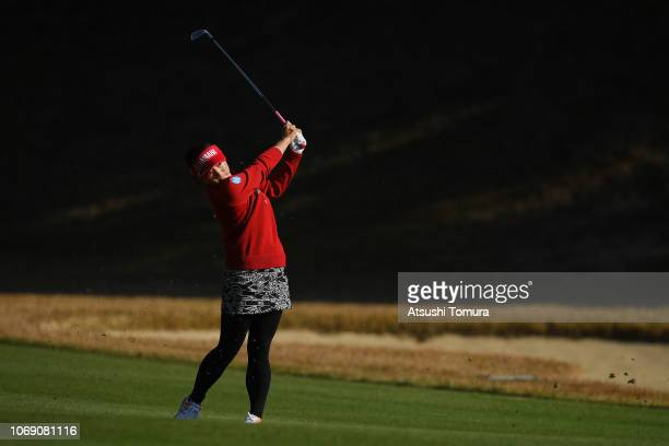 Chie Arimura of Japan hits her second shot on the 2nd hole during the final round of the Daio Paper Elleair Ladies Open at Elleair Golf Club...