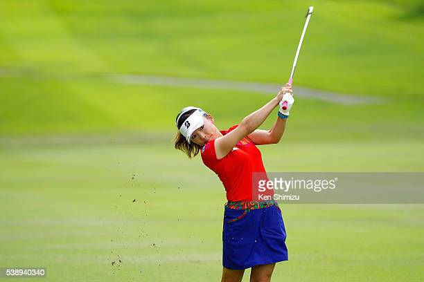 Chie Arimura of Japan hits her second shot on the 9th hole during the first round of the Suntory Ladies Open at the Rokko Kokusai Golf Club on June 9...