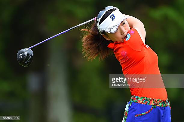 Chie Arimura of Japan hits her tee shot on the 13th hole during the first round of the Suntory Ladies Open at the Rokko Kokusai Golf Club on June 9...