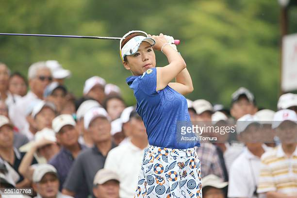 Chie Arimura of Japan hits her tee shot on the 1st hole during the first round of the meiji Cup 2016 at the Sapporo Kokusai Country Club on July 31...