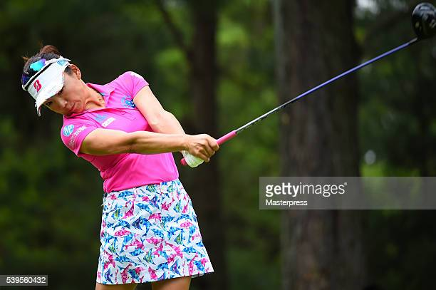 Chie Arimura of Japan hits her tee shot on the 2nd hole during the final round of the Suntory Ladies Open at the Rokko Kokusai Golf Club on June 12...