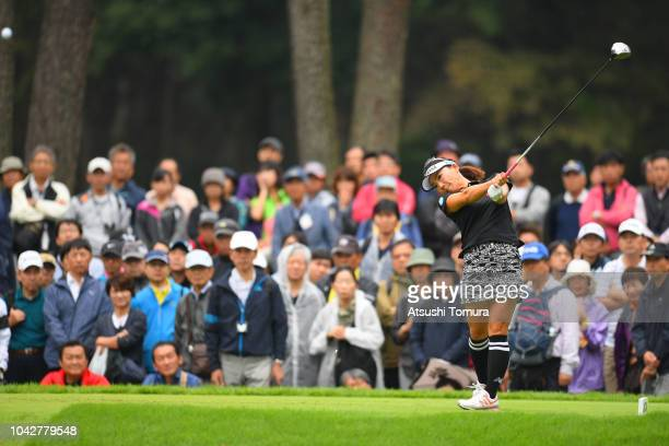 Chie Arimura of Japan hits her tee shot on the 3rd hole during the third round of the Japan Women's Open Golf Championship at Chiba Country Club Noda...