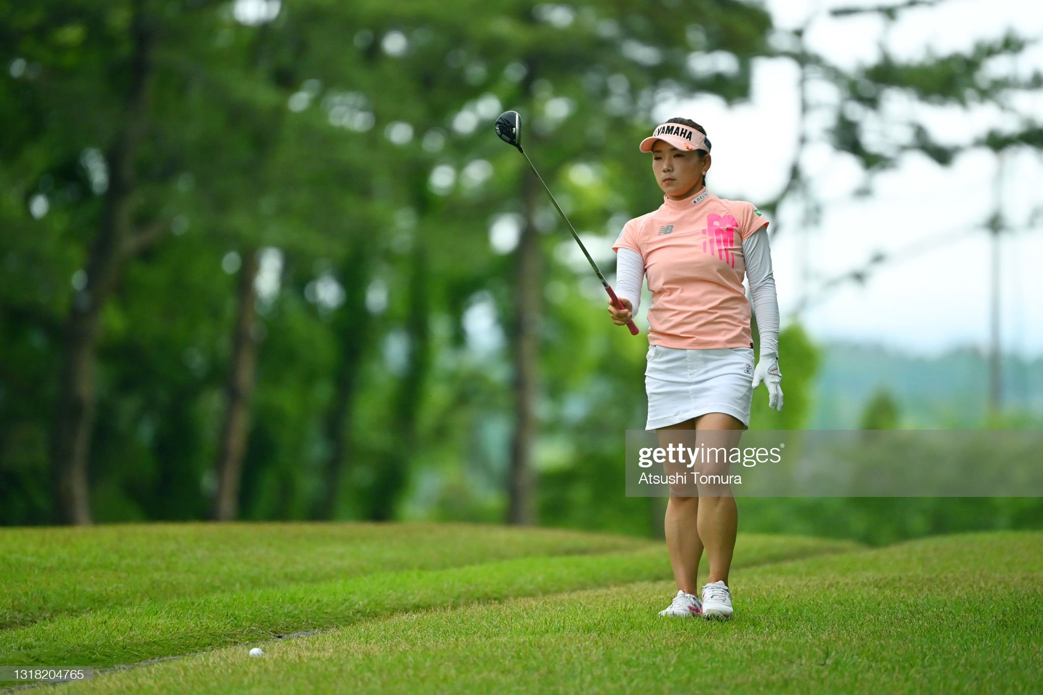 https://media.gettyimages.com/photos/chie-arimura-of-japan-is-seen-before-her-second-shot-on-the-1st-hole-picture-id1318204765?s=2048x2048