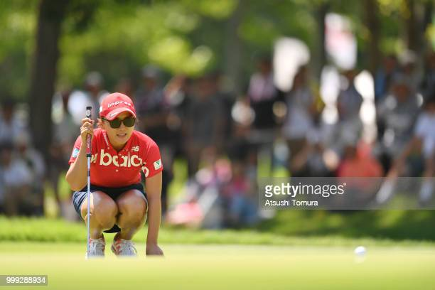 Chie Arimura of Japan lines up her putt on the 15th hole during the final round of the Samantha Thavasa Girls Collection Ladies Tournament at the...