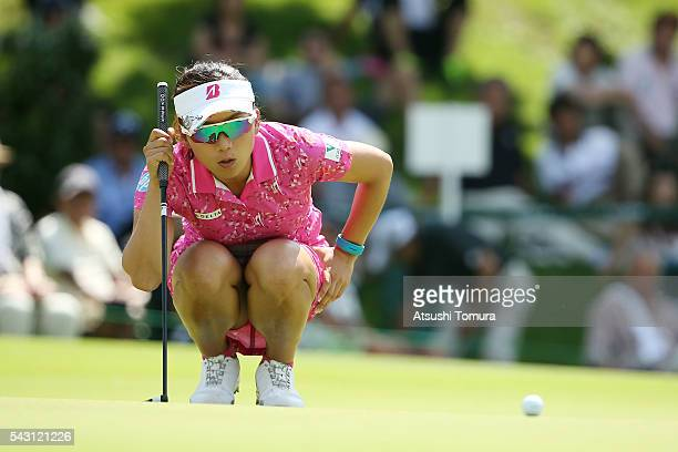 Chie Arimura of Japan lines up her putt on the 16th green during the final round of the Earth Mondamin Cup at the Camellia Hills Country Club on June...