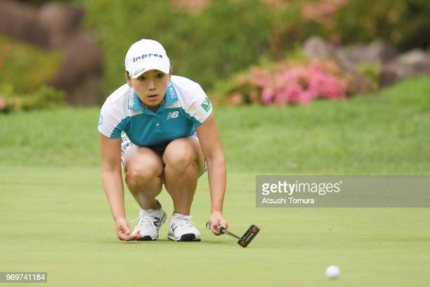 Chie Arimura of Japan lines up her putt on the 18th hole during the second round of the Suntory Ladies Open Golf Tournament at the Rokko Kokusai Golf...