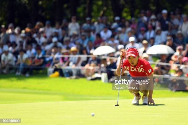 Chie Arimura of Japan lines up her putt on the 18th hole during the final round of the Samantha Thavasa Girls Collection Ladies Tournament at the...