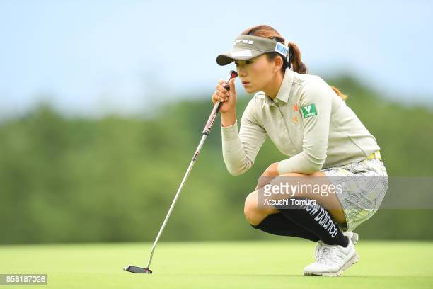 Chie Arimura of Japan lines up her putt on the 1st hole during the first round of Stanley Ladies Golf Tournament at the Tomei Country Club on October...
