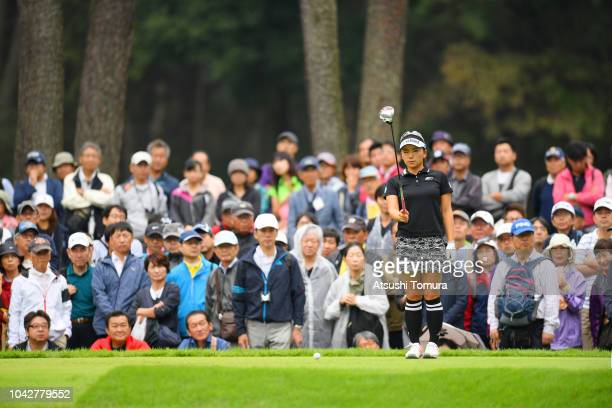 Chie Arimura of Japan lines up her tee shot on the 3rd hole during the third round of the Japan Women's Open Golf Championship at Chiba Country Club...